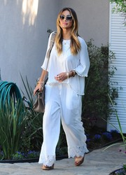 Nicole Scherzinger completed her outfit with a pair of lace-trimmed drawstring pants.