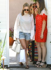 Elizabeth Olsen teamed her boxy top with a pair of denim cutoffs.