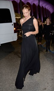Rosie Huntington-Whiteley looked fierce in a semi-sheer black one-shoulder dress by Beaufille while attending Rihanna's concert.