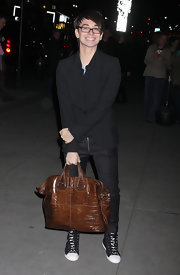"This oversized ""Nightingale"" bag looks fabulous in Christian Siriano's hands."
