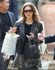 Jessica Alba was rocker-glam in a black leather moto jacket and a snakeskin-print skirt while attending Gwen Stefani's baby shower.