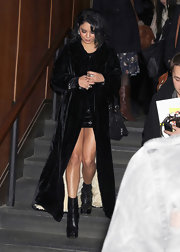 Vanessa Hudgens wore a dramatic black velvet floor length coat to the Jeremy Scott show.