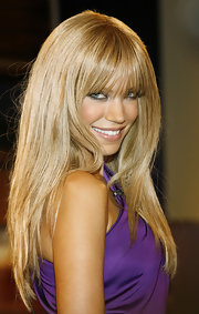 Sylvie van der Vaart was a bombshell with her hair styled straight with flirty bangs.