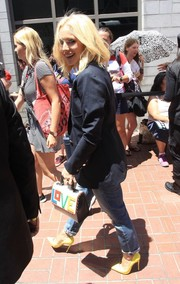 For her arm candy, Kristen Bell chose the adorable Les Petits Joueurs Alex Love top-handle bag.