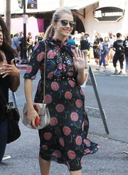 Teresa Palmer topped off her look with the celeb-favorite Dior So Real sunglasses.