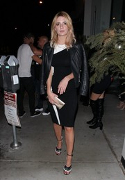 Mischa Barton added some warmth with a black leather jacket.