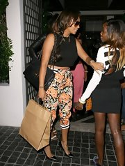 La La Anthony paired a black crop top with floral pants for a dinner out in West Hollywood.