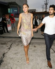 Ashley Madekwe cut an elegant figure on the streets of West Hollywood in a Dior lace cocktail dress in a blend of champagne, yellow, and pink.