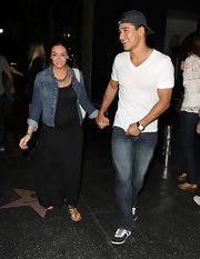 Courtney paired a denim jacket over her black maxi for a casual and cool look while out with husband, Mario Lopez.