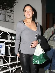Michelle Rodriguez teamed a gray scoopneck sweater with leather pants for a night out at Madeo Restaurant.