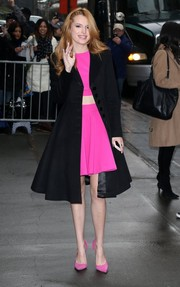 Bella Thorne added some serious elegance to her hot-pink crop-top and mini combo with a dressy black coat.