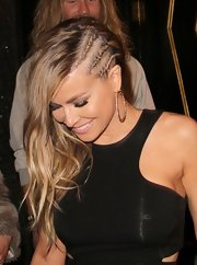 Carmen Electra showed off her signature honey locks with a long wavy 'do with cornrow braids.