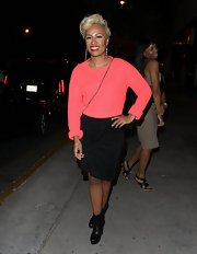 Emeli Sande kept her look classy with a black wrap pencil skirt.