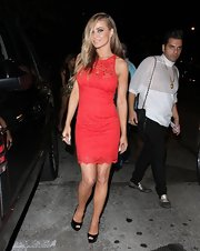 Carmen showed off her curves with this sleeveless red lace dress.
