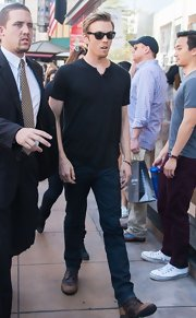 Jake Abel opted for a black v-neck for his casual and cool look on 'Extra!'