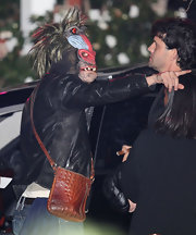 Leonardo DiCaprio attended Kate Hudson's Halloween party dressed as a baboon carrying a crocodile-skin shoulder bag.