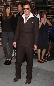Johnny Depp showed off his unique style with a chocolate brown striped suit.