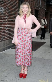 Chloe Grace Moretz arrived for her 'Late Show with Stephen Colbert' appearance looking sweet in a bowed pink button-down by Gucci.
