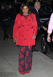 Underneath her coat, Mindy Kaling was girly in poppy-print separates by Lela Rose.