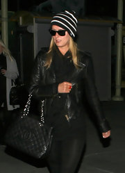 Nicky wore a striped knit beanie with her all black ensemble.
