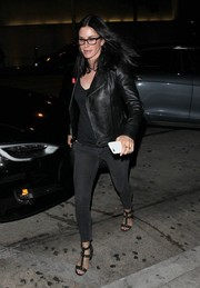 Courteney Cox sealed off her look with a pair of studded T-strap heels.