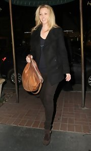 Lisa Kudrow kept her look super casual and cool with this black pea coat.