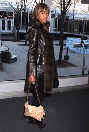 Eve's nude chain-strap bag was a bright finish to her all-black outfit at the Rebecca Minkoff fashion show.