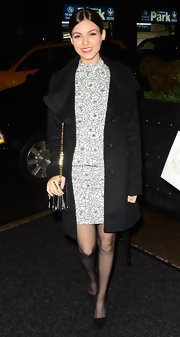 Victoria Justice's simple pea coat kept the attention on her gorgeous peplum dress.