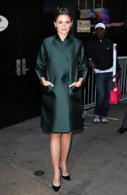Stana Katic arrived for her 'Good Morning America' appearance looking classy in an emerald-green coat.
