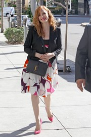 Jessica Chastain pulled her outfit together with a black YSL shoulder bag.