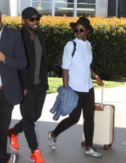 Lupita Nyong'o pushed along a white and tan rollerboard as she made her way through the airport.