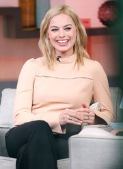 Margot Robbie wore her hair in loose waves for an appearance on 'Good Morning America.'