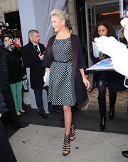 Cameron Diaz modernized her fit-and-flare polka dot dress with a cropped sleeve color-block coat.