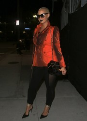 Amber Rose styled her look with a furry chain-strap bag.