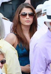 Aishwarya Rai donned a pair of classic aviators with her blue summer dress for the French Open.