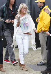 Hayley Roberts was dressed for comfort in a loose shirt, jeans, and flat boots.