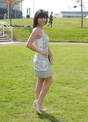 Roxanne Pallett exuded carefree elegance in a sleeveless graphic-print dress.