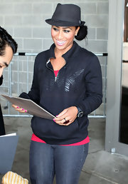 Nicole Alexander's black half-zip sweater was a low-key complement to her hot-pink shirt and skinnies.