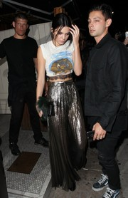 Kendall Jenner added major shine with a pair of pleated gold palazzo pants by Talbot Runhof.