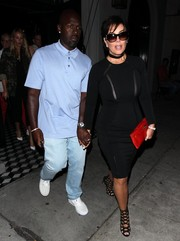 Kris Jenner styled her dress with sexy black cage heels.