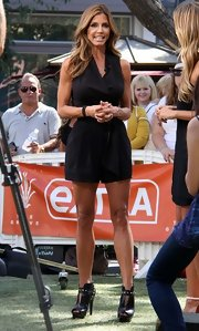 Charisma wore a structured romper with pleats for her look on 'Extra!'