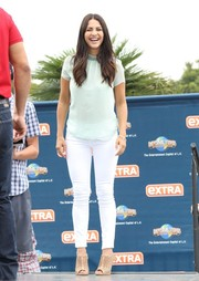 Andi Dorfman was casual yet cute in a pale-blue high-neck blouse during her appearance on 'Extra.'
