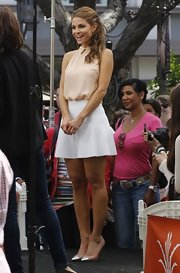 Maria Menounos chose a nude halter blouse to pair with a white skirt for her chic look on 'Extra.'