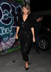 Taylor Swift played the matching game with this Juliette Hogan sequin pants and top ensemble.