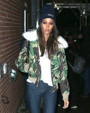 Joan Smalls kept warm with a personalized beanie as she left the La Perla fashion show.