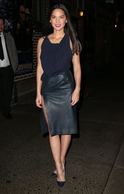 Olivia Munn rocked a dangerously high slit with this dual-textured navy J. Mendel dress during her visit to 'Letterman.'