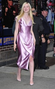Elle Fanning cut an ultra-feminine figure in a pink Vivienne Westwood corset dress with a draped neckline and skirt as she left 'Letterman.'
