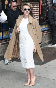 Underneath her coat, Scarlett Johansson wore a lovely white Roland Mouret dress featuring a laser-cut cut skirt and a pleated bodice.