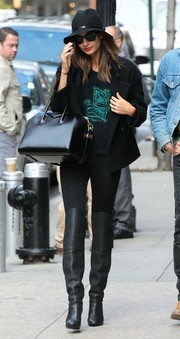 Lily Aldridge topped off her all-black ensemble with a classic pea coat.