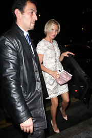 Cameron Diaz added femininity to her lovely lace number with a pink frame clutch.